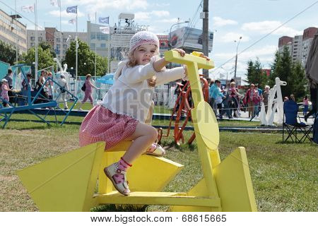 Perm, Russia - Jun 13, 2013: Girl On Bike With Triangular Wheels In White Nights Town. Million Peopl
