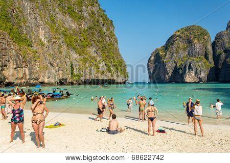 PHI PHI ISLAND,THAILAND-FEBRUARY 25, 2014:Tourists on the wonderful Maya beach of Phi Phi Leh island Thailand on 25 February, 2014.