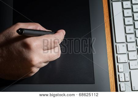 Close-up Of Hands Drawing On Graphic Tablet