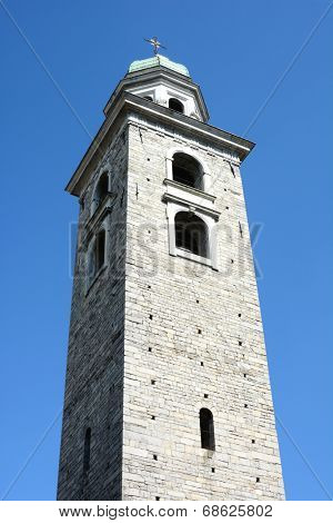 LUGANO, SWITZERLAND - JULY 6, 2014: Bell Tower of The Cathedral of Saint Lawrence. The tower is in the Baroque style with an octagonal lantern covered by a cupola, designed by Costante Tencalla.