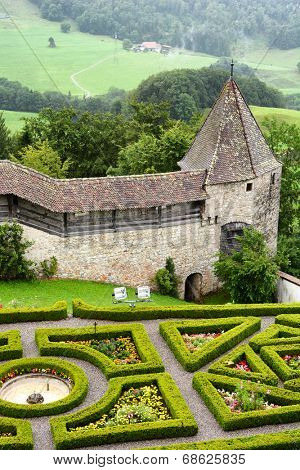 GRUYERES, SWITZERLAND - JULY 8, 2014: Garden and ramparts at Gruyeres Castle. Located in the medieval town of Gruyeres and built between 1270 & 1282, it's one of the most famous castles in Switzerland