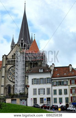 LAUSANNE, SWITZERLAND - JULY 7, 2014: The Cathedral of Notre Dame of Lausanne. The Cathedral is currently undergoing renovation and is partially covered with scaffolding.
