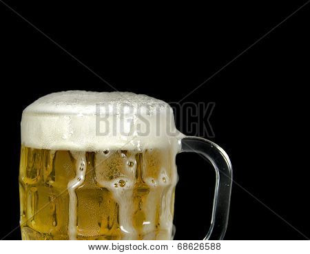 beer overflowing in mug