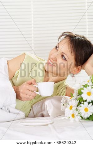 Beautiful female with cup
