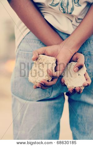 Palestinian Intifada boy with rocks in hands ready for fight