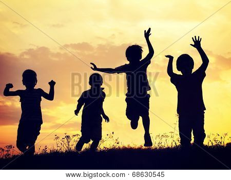 Children playing on summer sunset meadow