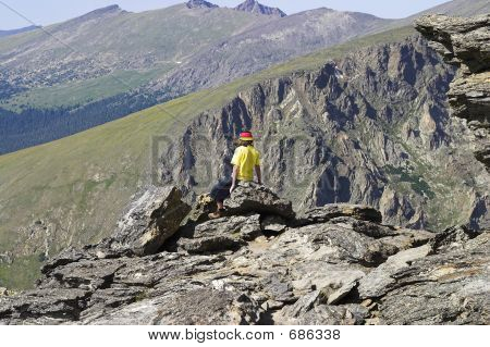 Youth On Rocks In Rocky Mountain National Park