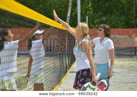 MOSCOW, RUSSIA - JULY 17, 2014: Woman teams Belarus and China after the match during ITF Beach Tennis World Team Championship. Belarus won the round 3-0