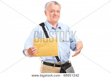 Mature mailman holding an envelope isolated on white background