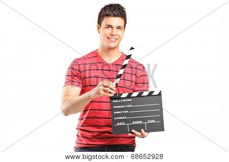 Young filmmaker holding a movie-clapper isolated on white background