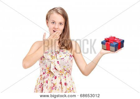 Young girl holding a present isolated on white background