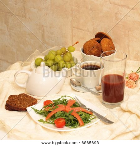 Healthy Eating: Bread, Salad Of Arugula, Salmon, Grapes, Cookies
