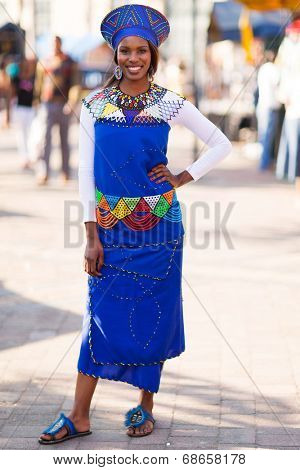 beautiful african woman in traditional attire in the city