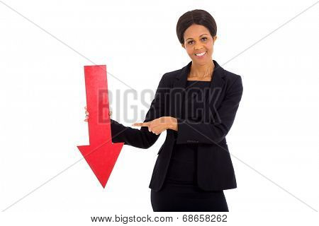mature african businesswoman holding red arrow pointing down on white background