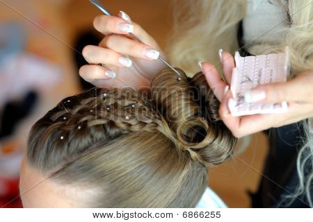 Woman's Hands Making A Hairstyle