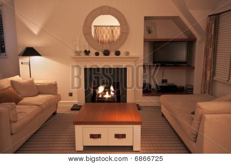 Luxurious Modern Living Room With Lit Fire