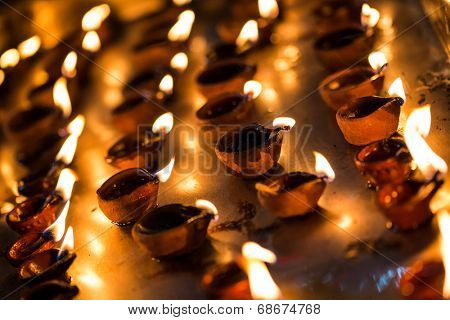 Burning candles in the Indian temple. Diwali - the festival of lights.