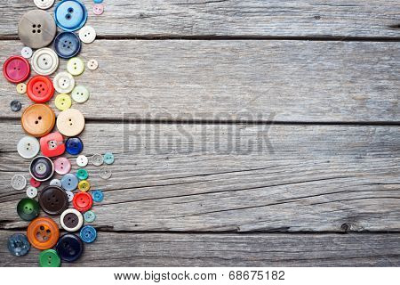 thread and sewing on wooden boards
