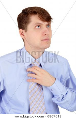 Man Adjusts Blue Tie Isolated On White
