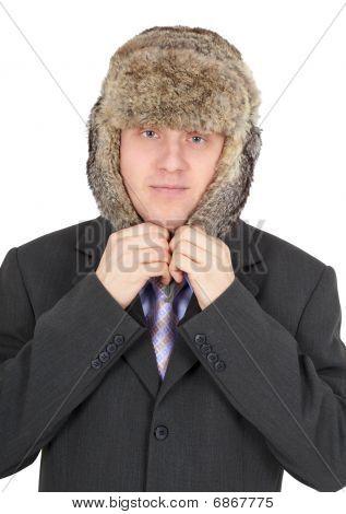 Man Puts On Head A Fur Hat