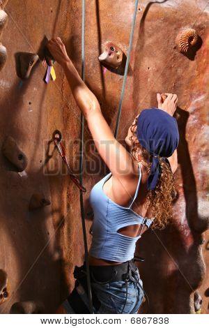 Rock climbing woman