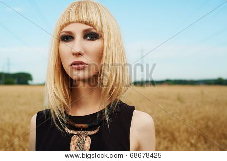 blond girl in the fields
