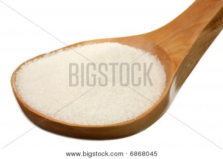 Sugar in a wooden spoon
