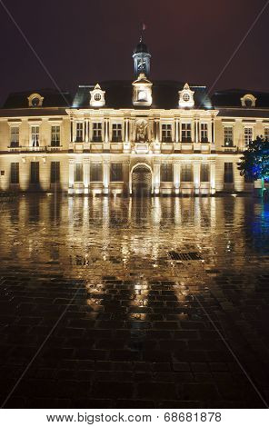 City Hall in the rain at night