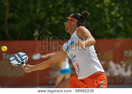 MOSCOW, RUSSIA - JULY 20, 2014: Petros Baghdatis of Cyprus in the match against Hungary during ITF Beach Tennis World Team Championship. Cyprus won 2-1