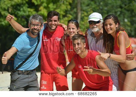 MOSCOW, RUSSIA - JULY 20, 2014: Team Spain celebrates the 5th place in ITF Beach Tennis World Team Championship. Spain beats Venezuela 2-0