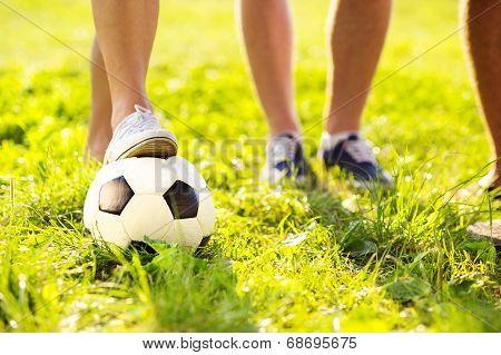 Feet and football ball