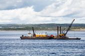 stock photo of barge  - A working barge off the coast of Nova Scotia Canada - JPG