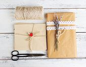 foto of french culture  - Natural style handcrafted gift box on wooden background - JPG