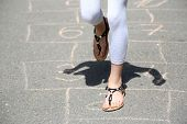 image of hopscotch  - Cute girl playing hopscotch outside - JPG