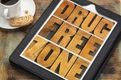 drug free zone word abstract in vintage letterpress wood type on a digital tablet with a cup of coffee poster