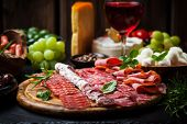 picture of cheese platter  - Antipasto and catering platter with different appetizers - JPG