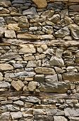 picture of gneiss  - Old stone wall with wooden beams closeup