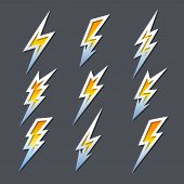 stock photo of fiery  - Set of nine different fiery orange cartoon zigzag lightning bolts or electricity icons in different shapes with metallic outlines - JPG