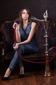 stock photo of hookah  - The beautiful sensual woman with a hookah - JPG
