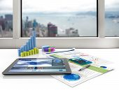 picture of graph  - tablet and financial graphs on a white desk - JPG