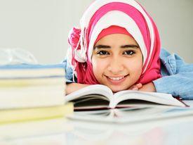 stock photo of muslim  - Beautiful Arabic Muslim girl reading on college - JPG