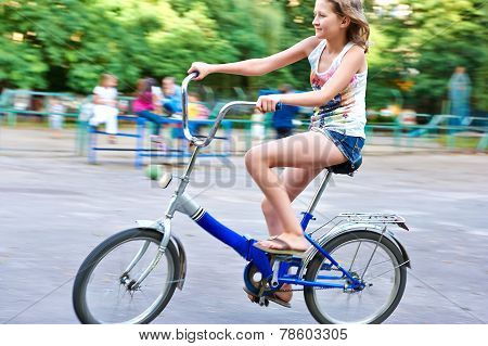 Twelve Year Old Girl On A Bicycle