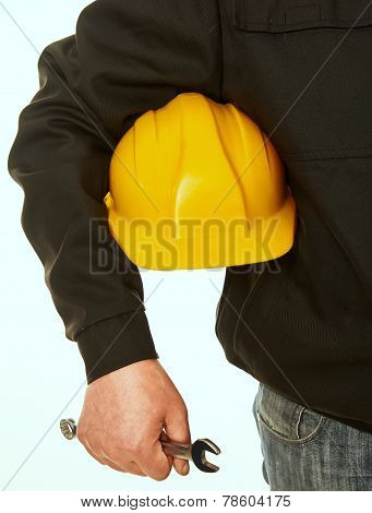 Yellow Hard Hat And Spanner In Hand Working Man
