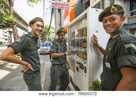 BANGKOK, THAILAND - DEC 17, 2014: Unidentified young Thai soldiers posing for camera on a street in the city center. Military service runs on a contract (65%) and mandatory. Draft age - 20-55 years.