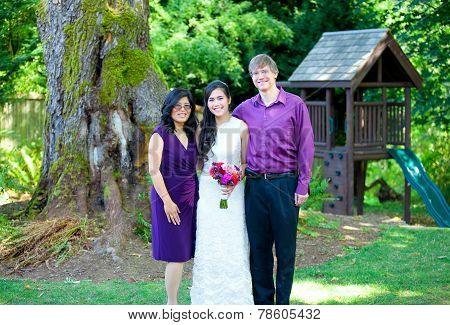 Beautiful Biracial Bride Standing With Her Parents. Diversity.