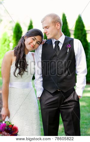 Caucasian Groom Holding His Biracial Bride, Smiling. Diverse Couple.