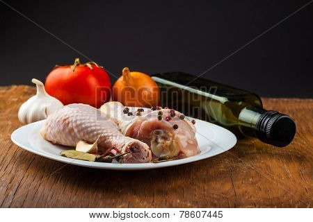 Raw Chicken Legs On Wooden Board With Spices