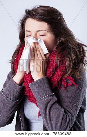Woman In Scarf Sneezing