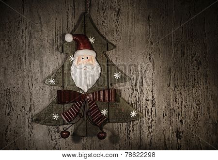 Grunge photo of Christmastime decoration, decorative wooden Christmas tree with Santa Claus ornament, happy New Year, holiday greeting card, home ornate, retro style image, xmas background