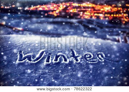 Snowy Christmas background, handwriting on the snow, beautiful winter nature at night, Xmas holidays theme, dark textured photo, selective focus on the text